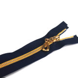 A tração a mais de alta qualidade do Zipper do metal dos dentes do ouro