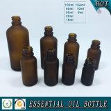 Brown geou o frasco de vidro de petróleo essencial