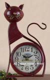Orologio antico decorativo del piano d'appoggio del metallo di figura del gatto nero dell'annata