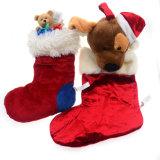 Le feutre de peluche de bas de Noël badine le jouet de cadeau