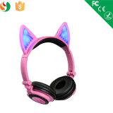 Écouteur sans fil rougeoyant coloré de Bluetooth d'oreille de chat d'éclairage LED
