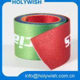 Los accesorios baratos de la ropa envolvió la cinta con insignia de encargo