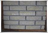 La parete esterna copre di tegoli i mattoni artificiali della pietra della coltura per la pietra di arte
