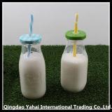 Bottiglia per il latte di vetro libera/vaso di vetro con il coperchio e la paglia