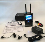 Il mini video scanner tenuto in mano riceve il cacciatore senza fili del rivelatore della macchina fotografica del segnale