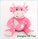 Le jouet animal se reposant de vache à Lovly bourré badine le jouet