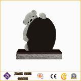 De Grafsteen en Memeorial van het graniet met Standbeeld