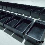 Kingkonreeの卸し売り光沢がある黒い石造りの樹脂の軸受けの洗面器