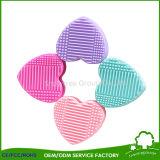 Producto de limpieza de discos de cepillo Shaped del maquillaje del silicón del medio huevo con el sostenedor de cepillo