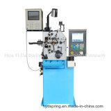 Machine de ressort de compression et machine automatique de ressort avec biaxial