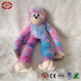 Le singe reposant le cadeau mou de peluche mignonne badine le jouet neuf de couleur