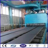Passaggio del trasportatore a rulli tramite la strumentazione di pulizia della macchina di granigliatura