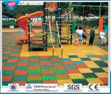 Le mattonelle di gomma del rifornimento, mattonelle di pavimento di gomma, mattonelle di gomma esterne mettono in mostra le mattonelle della gomma del campo da giuoco delle mattonelle della gomma