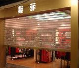 Tienda de rodillo transparente cristal y puerta de entrada