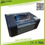 Nonmentalの二酸化炭素レーザーの切断および彫版機械が付いている緑の切断の小さい機械