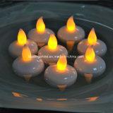 La vela flotante Tealight que oscila impermeable del LED mira al trasluz la decoración amarilla de la tarjeta del día de San Valentín de la Navidad de la boda