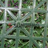 Le mur vert mure la haie artificielle de plastique de barrière extérieure de haies