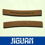 La venta caliente de la alta calidad crea la etiqueta plástica de la caída para requisitos particulares de los pantalones vaqueros