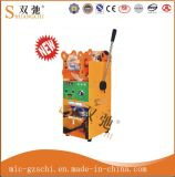 手動コップのシーリング機械パッキング機械装置のコップのシーラー