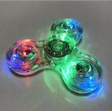 El hilandero cristalino clásico del dedo con la luz colorida del LED
