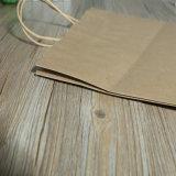 衣服の包装のための多彩なプリントが付いているクラフト紙袋