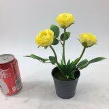 高い陶磁器のびんの人工花のBonsai