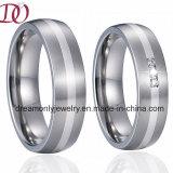 L'acciaio inossidabile dell'intarsio d'argento unico squilla la fascia di cerimonia nuziale degli anelli delle coppie di accoppiamenti