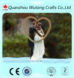 La cerimonia nuziale della resina favorisce i centri della Tabella dei Figurines delle coppie di amore della decorazione