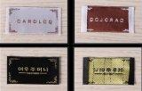 Escritura de la etiqueta tejida la mejor tela vendedora caliente de la ropa del precio de la buena calidad