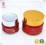 Vaso rotondo lucido rosso con la protezione dorata per l'imballaggio cosmetico