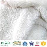Il tessuto 100% del maglione del tessuto della coperta del panno morbido di Sherpa del poliestere calza il tessuto