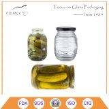 Vaso d'inscatolamento di vetro con la protezione per il sottaceto del cetriolo