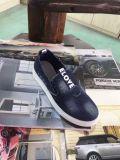 Material jeans sapatos de lona em stock