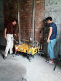 Mur de briques concret de construction plâtrant la machine de robot de stuc de rendu
