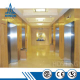 Edifício comercial elevador com pequena sala da máquina