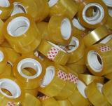 Fita amarelada dos artigos de papelaria da cor de 6 Rolls no saco desobstruído