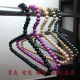 Cintres de perle pour des vêtements