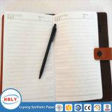 Lápis - penas de Ballpoint e caderno de papel de pedra das penas de fonte