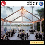 Spiaggia con la tenda libera all'interno della tenda romantica del baldacchino di cerimonia nuziale della tenda con il coperchio di PVC trasparente