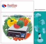 電子価格のスケールの重量を量っている高品質のフルーツ野菜