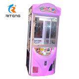 娯楽屋内ゲームの硬貨によって作動させる硬貨の補助機関車の催し物の人形のおもちゃの爪クレーン機械