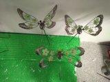 Incandescenza della decorazione del metallo della decorazione del metallo nella decorazione scura del giardino