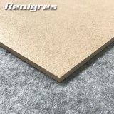 広州の産業ベージュ具体的な内部は磁器のタイルの台所のための無作法な床タイルに値を付ける