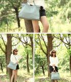 As mulheres a tiracolo em pele de seixos saco de mão de moda