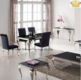 現代黒い光沢のガラスステンレス鋼のダイニングテーブルは椅子とセットした