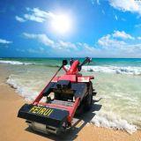 La arena de playa de la máquina de limpieza