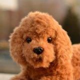 Boneca enchida do cão da peluche