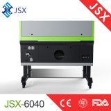 Kleine Nichtmetall Jsx-6040 CO2 Laser-Stich-Ausschnitt-Tischplattenmaschine