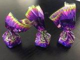 Dispositivo per l'impaccettamento di singola torsione del cioccolato