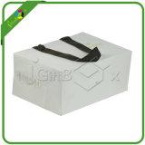 Bolso de compras de papel blanco con asas